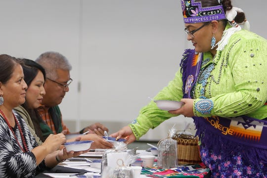 Ms. Indian San Juan College 2017-2018 Kahlaya Rose McKinney distributes blue corn mush to judges on Tuesday at San Juan College Henderson Fine Arts Center in Farmington.