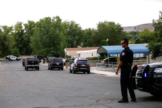 Farmington police officers close off a section of Hollywood Street while investigating a shooting today in Farmington.