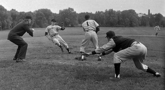 Pete Dawkins slides into third base during a Cranbrook baseball game.