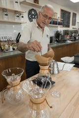 Anwar Zahr makes pour-over coffee in a Chemex, using freshly-ground Kenyan AA coffee beans.
