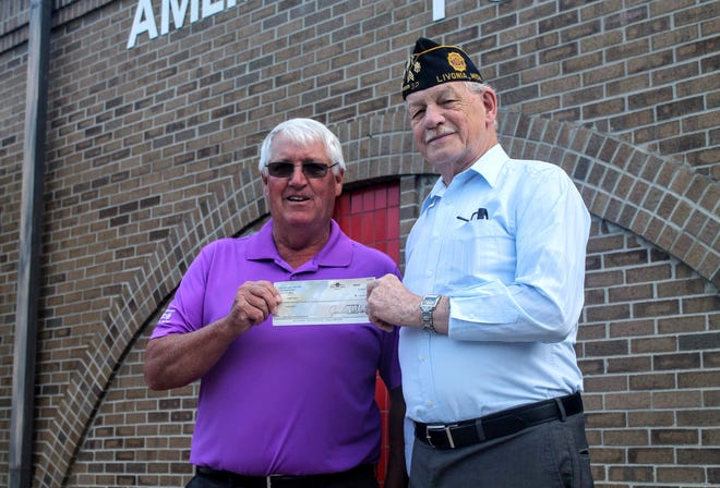 Northville Township resident Joe Evans (left) stands with American Legion Post 32 Cmdr. Larry Fenner. Evans won the King of Diamonds drawing at the post, taking home more than $124,000.