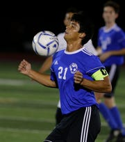 Oshkosh West's Edgar Heredia chests the ball during their match against Fond du Lac on Sept. 18 on JJ Keller Field at Titan Stadium in Oshkosh.