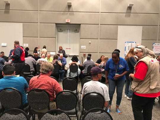 The American Red Cross and San Bernardino County staff assist evacuees in the Emergency Repatriation Center at Ontario Convention Center.