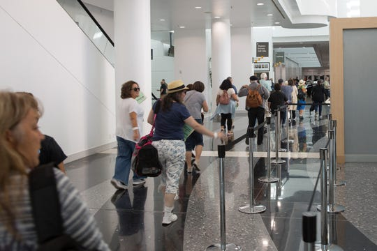 Volunteer evacuees filed into the Ontario Convention Center during the California Emergency Repatriation Exercise.