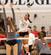 Xavier Preparatory's Golden Hinchen, spikes the ball for a point against Palm Desert High School during the second set of their game at Xavier on September 18, 2018. Xavier won the game.