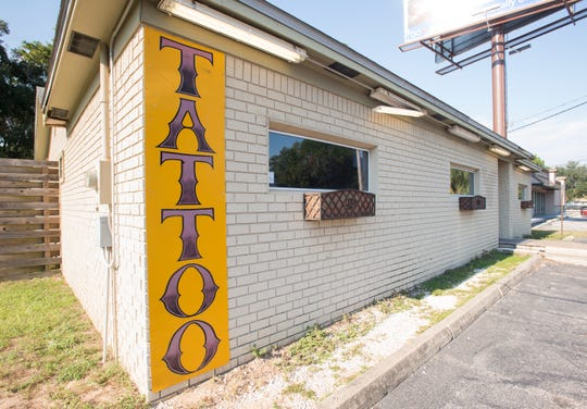 A tattoo studio on the north side of Barrancas Avenue in Pensacola on Wednesday, September 19, 2018.