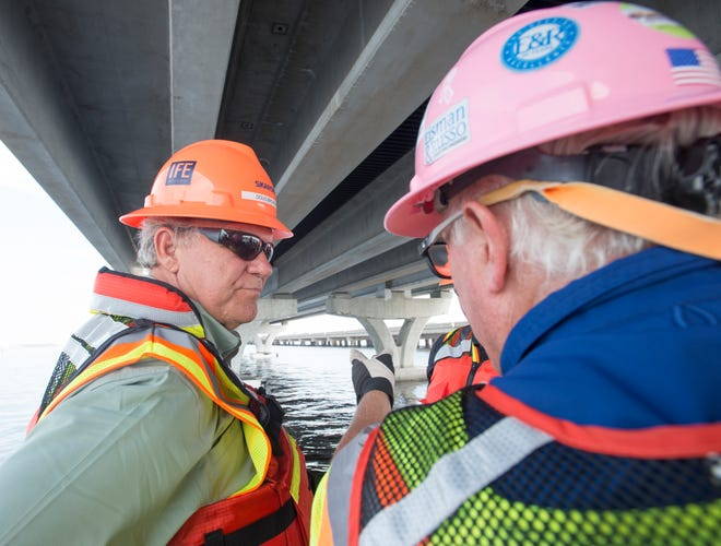 State Sen. Doug Broxson, left, listens as Brett Pielstick, program director withEisman & Russo Consulting Engineers, talks Wednesday about the construction of the new Pensacola Bay Bridge during a tour.