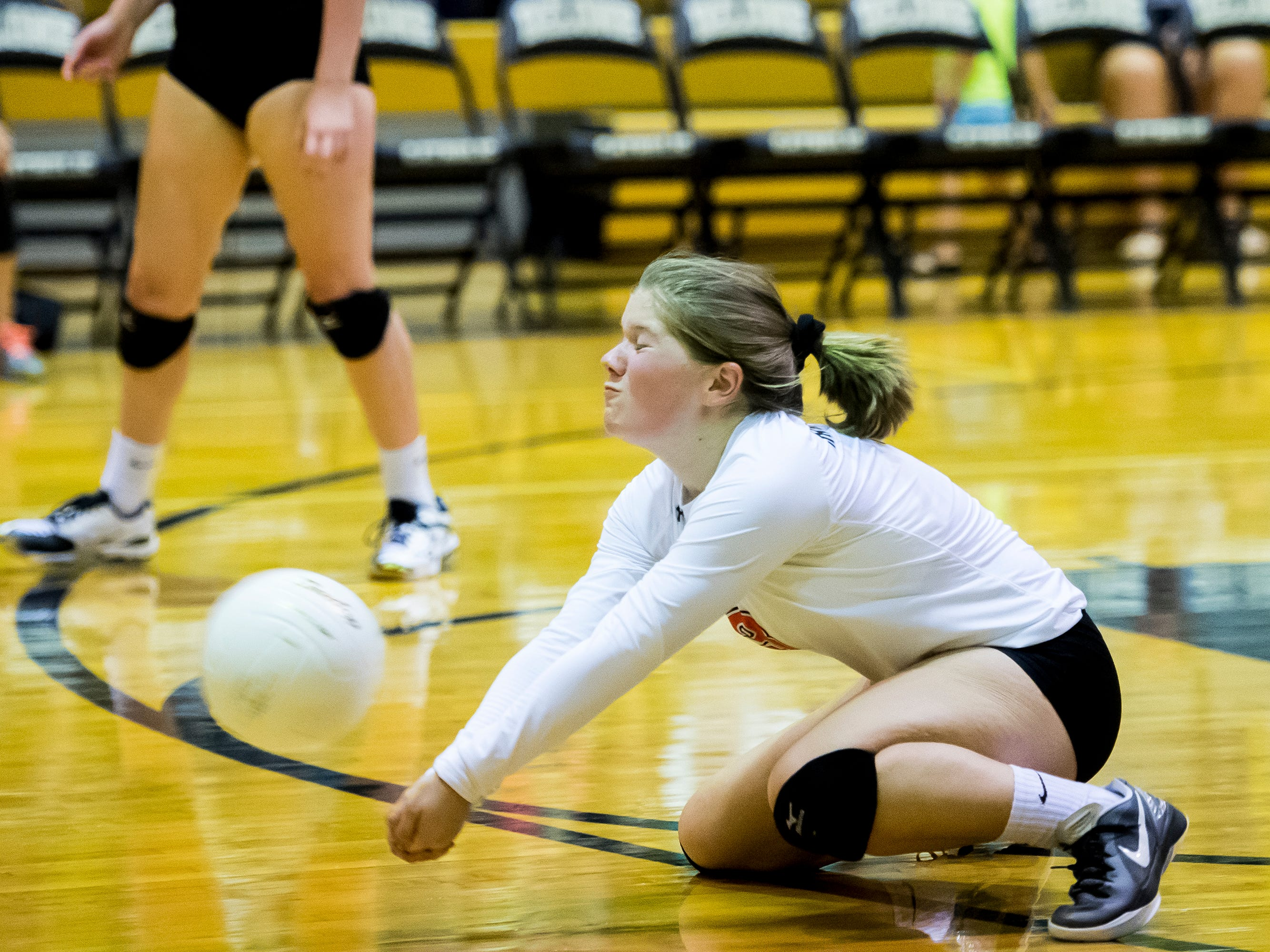 Hanover libero Sierra Stevens makes a dig during play against Delone Catholic on Tuesday, September 18, 2018. The Hawkettes fell in three straight sets;  25-16, 25-19, 25-14.