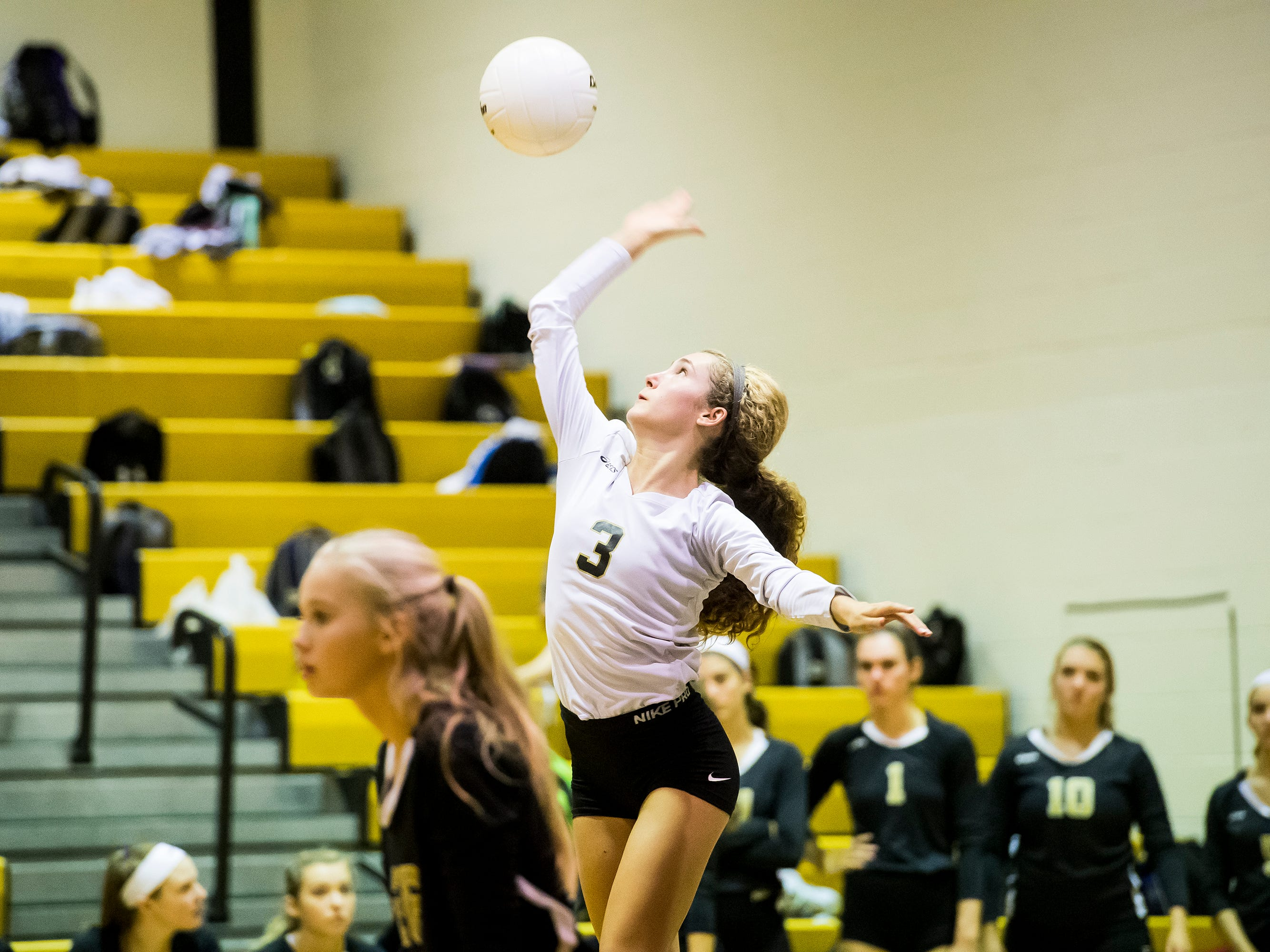 Delone Catholic's Lauren Trummer serves the ball to Hanover on Tuesday, September 18, 2018. The Squirettes swept the Hawkettes in three sets; 25-16, 25-19, 25-14.