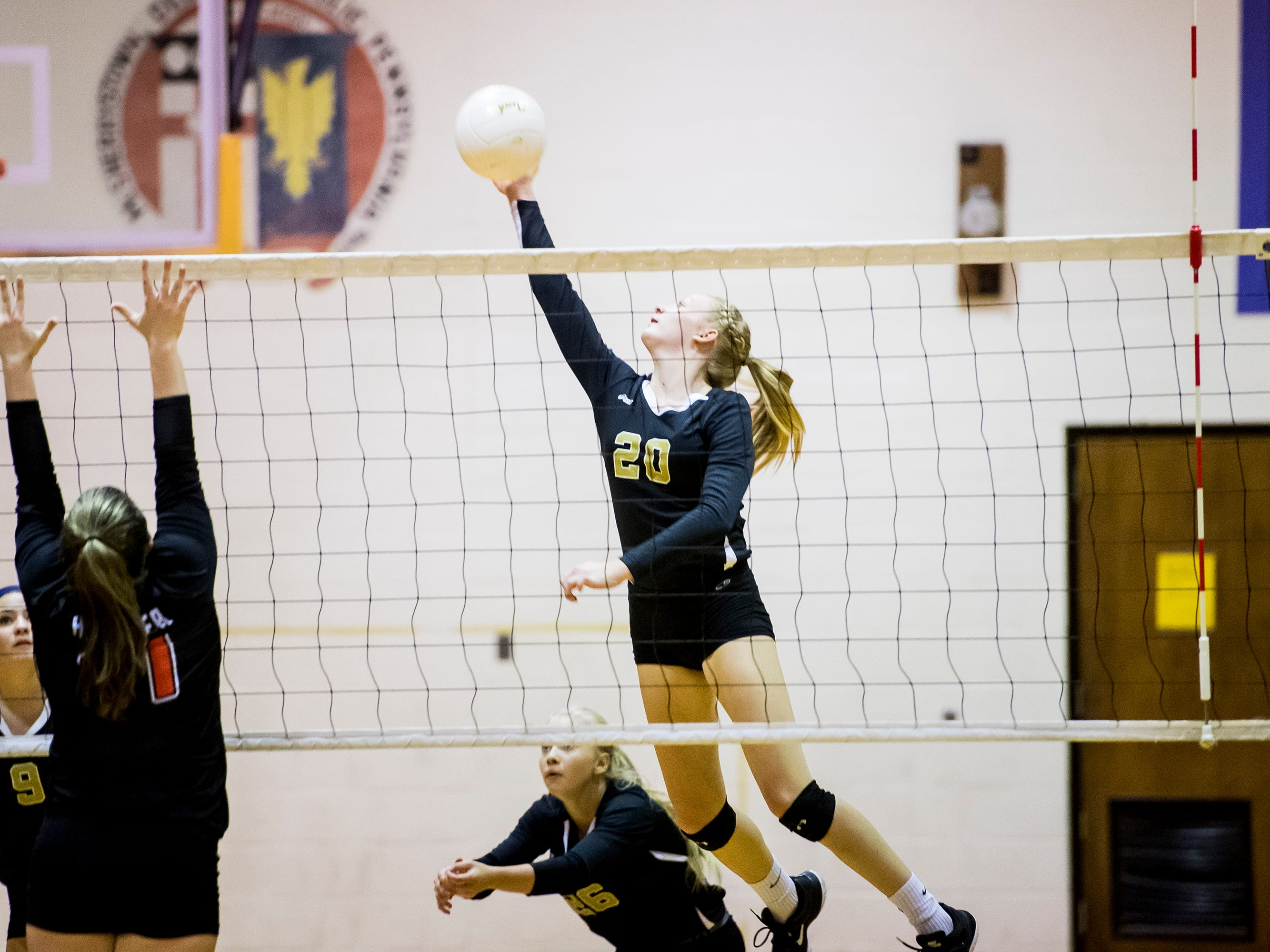 Delone Catholic's Brooke Lawyer hits the ball during play against Hanover on Tuesday, September 18, 2018. The Squirettes swept the Hawkettes 25-16, 25-19, 25-14.