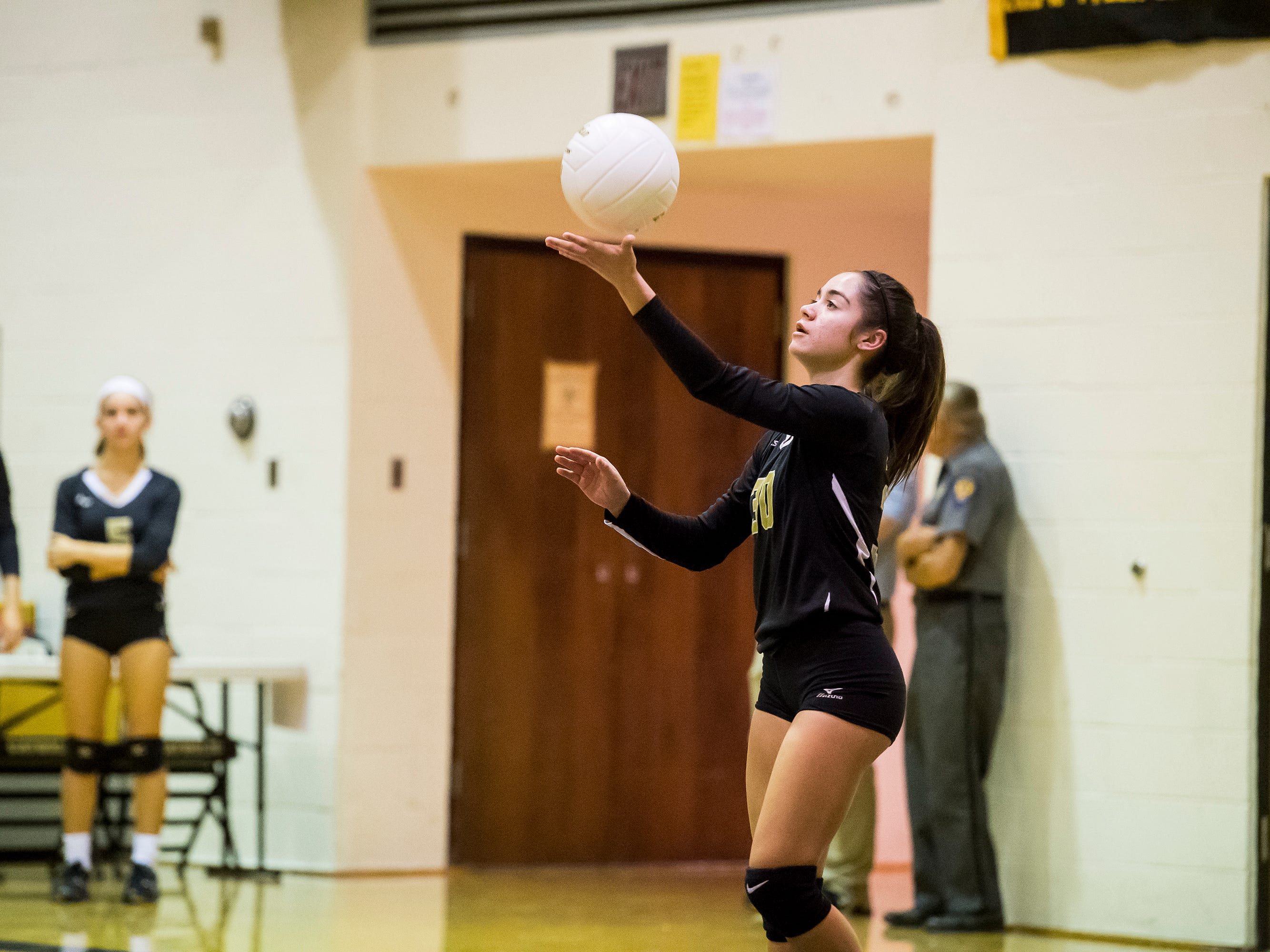 Delone Catholic's Janina Romero serves the ball to Hanover on Tuesday, September 18, 2018. The Squirettes swept the Hawkettes 25-16, 25-19, 25-14.