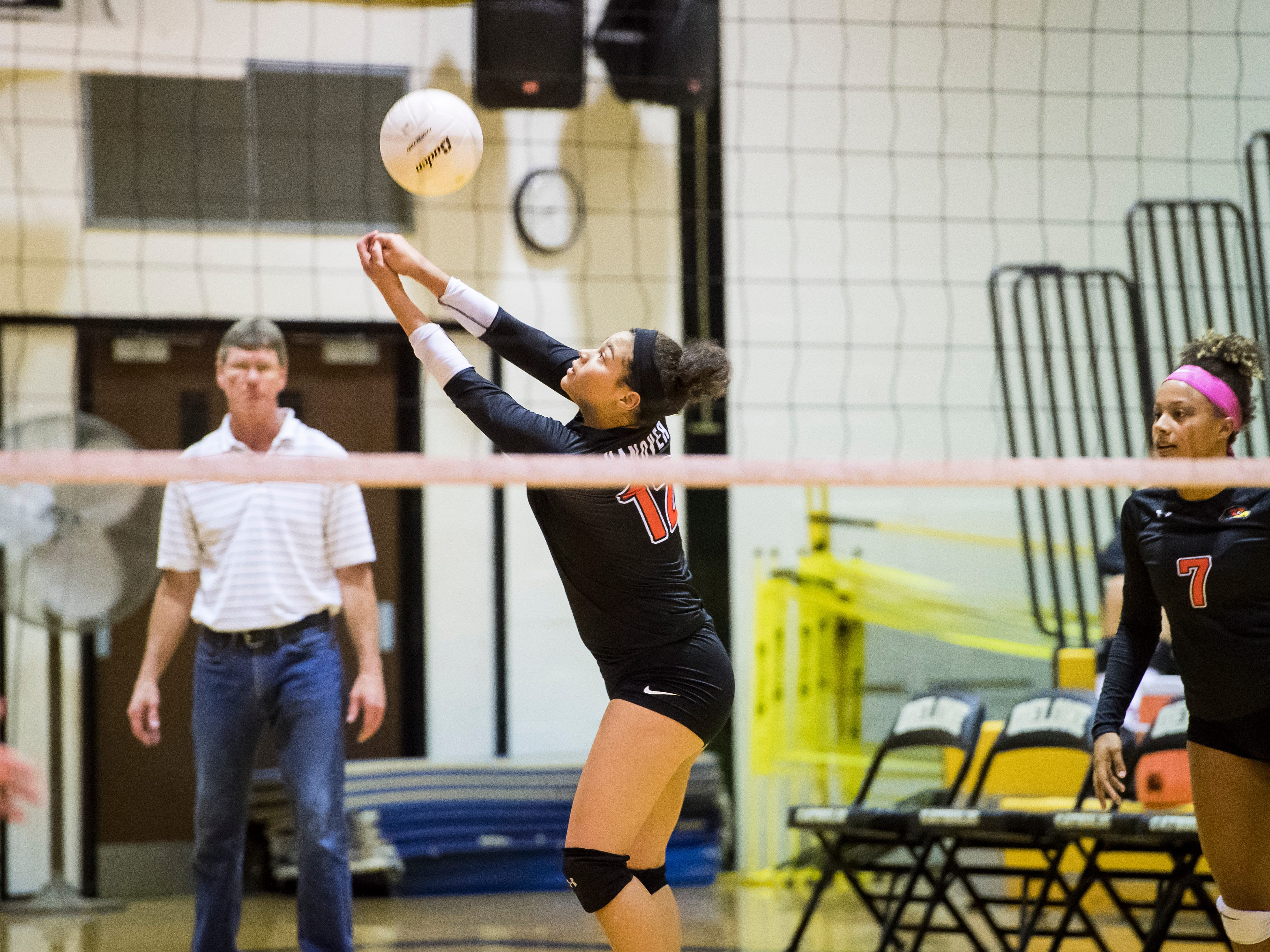 Hanover's Nakhaiya Jacobs hits the ball to Delone Catholic on Tuesday, September 18, 2018. The Hawkettes fell in three sets; 25-16, 25-19, 25-14.