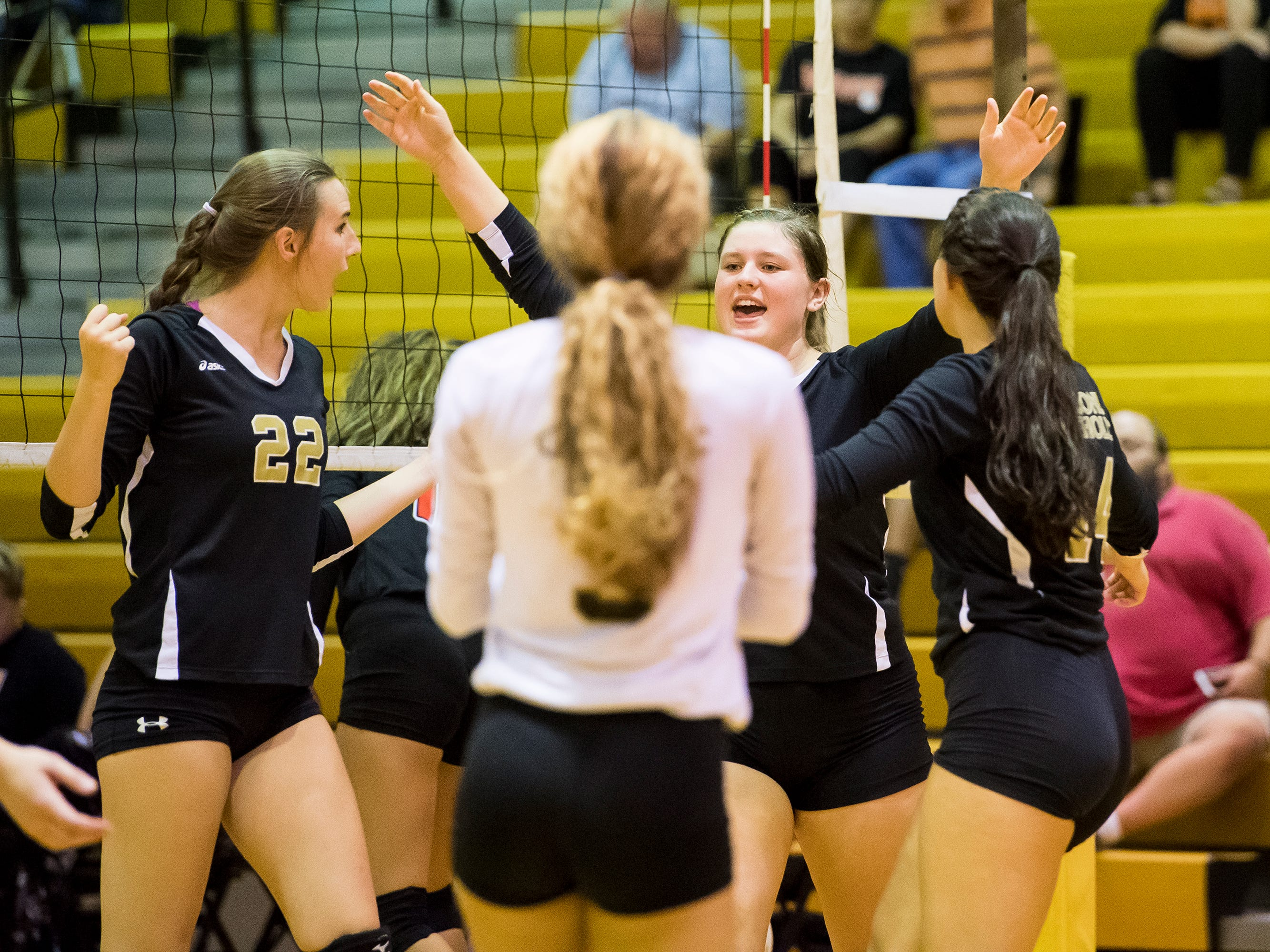 Delone Catholic players celebrate a point during play against Hanover on Tuesday, September 18, 2018. The Squirettes swept the Hawkettes 25-16, 25-19, 25-14.