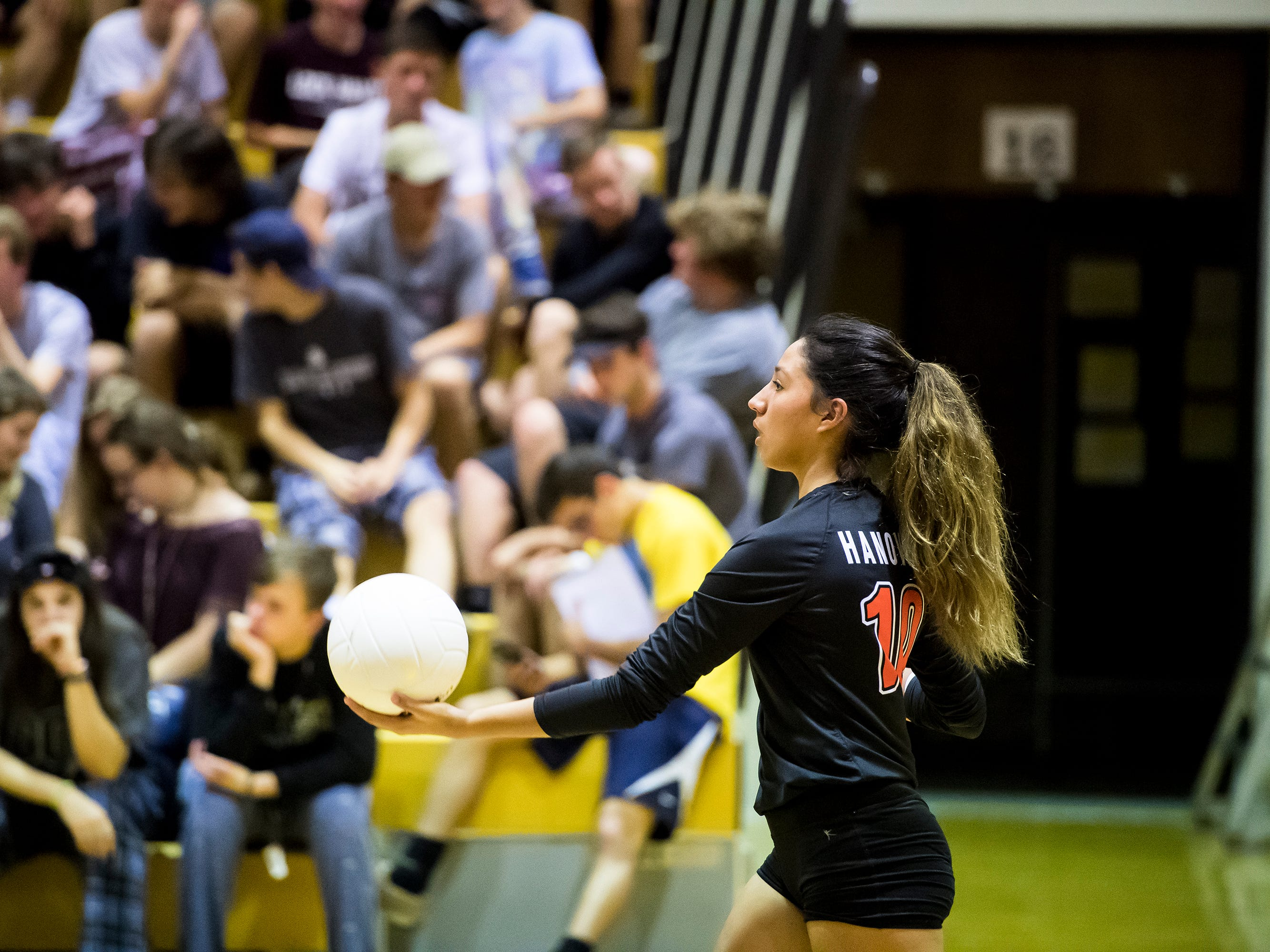 Hanover's Nancy Hernandez prepares to serve the ball to Delone Catholic on Tuesday, September 18, 2018. The Hawkettes fell in three straight sets;  25-16, 25-19, 25-14.