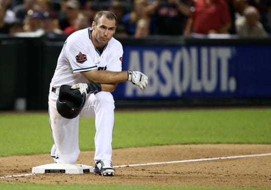 Paul Goldschmidt waits at third base while Steven Souza Jr. is tossed from the game against the Atlanta Braves in the eighth inning on Sep. 6, 2018, at Chase Field in Phoenix, Ariz.