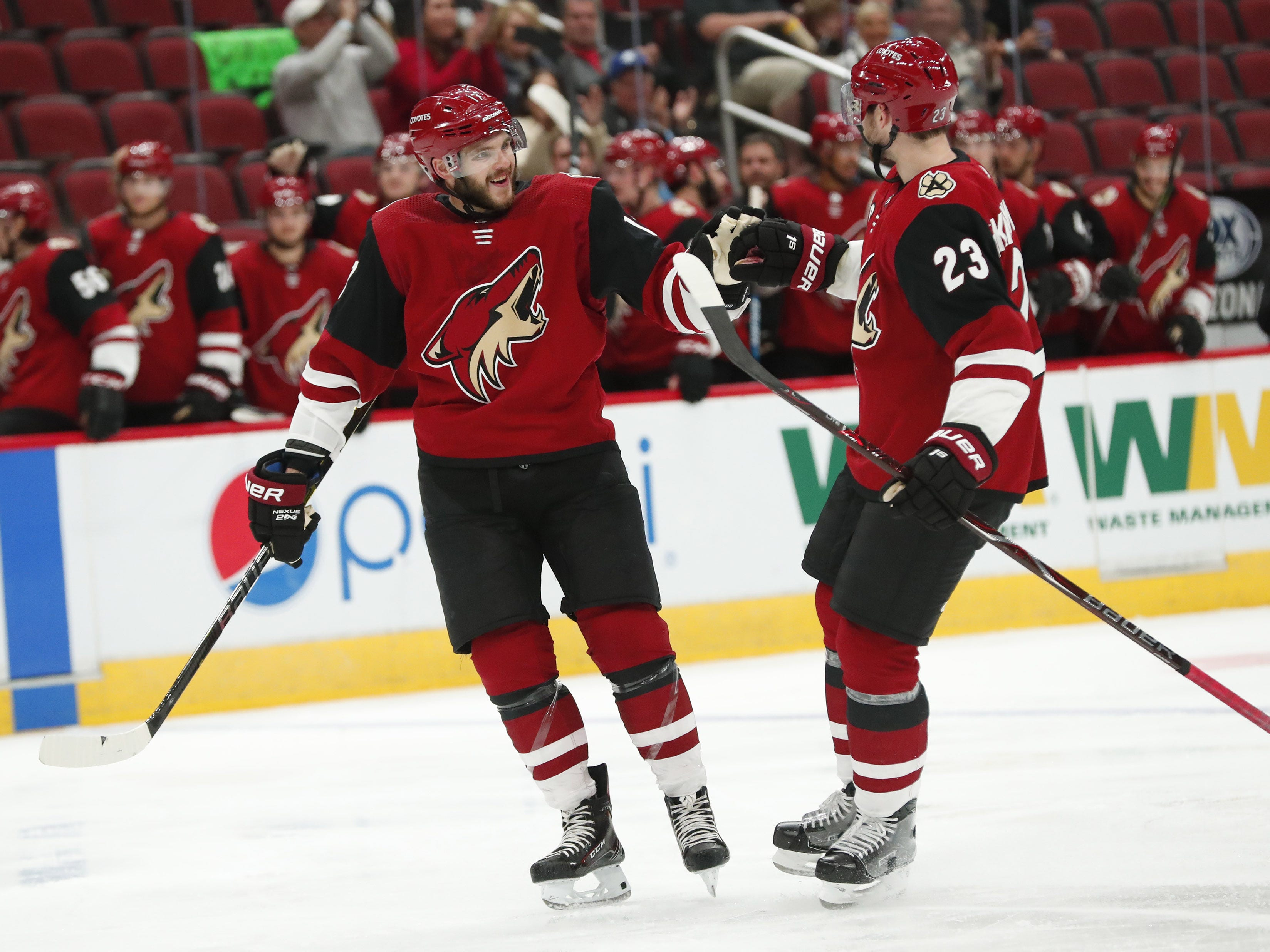 Arizona Coyotes center Alex Galchenyuk (17) and Arizona Coyotes defenseman Oliver Ekman-Larsson (23) celebrate a goal against the Los Angeles Kings in the second period during preseason NHL action at Gila River Arena in Glendale, Ariz. September 18, 2018.