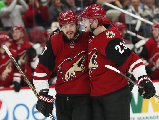 Alex Galchenyuk and Oliver Ekman-Larsson celebrate after connecting for a goal during the second period of a preseason game against the Kings at Gila River Arena.