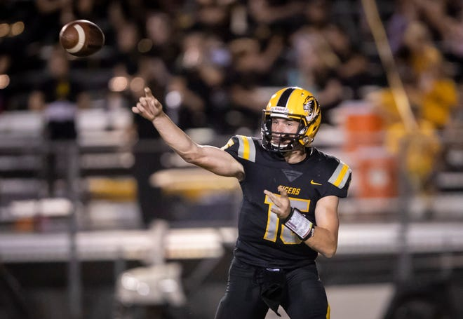 Gilbert Tigers junior quarterback Will Plummer (15) of the throws the ball against the Notre Dame Prep Saints at Gilbert High School on Friday, August 31, 2018 in Gilbert, Arizona.