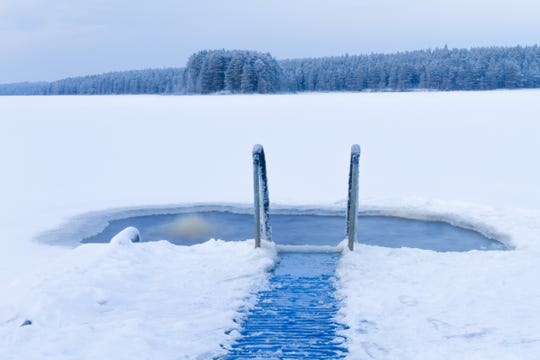 Finns often enjoy a dip in an ice hole, such as this one outside Kuhmo, Finland.