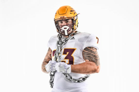 ASU's Cohl Cabral shows off the uniform the Sun Devils will wear at Washington on Saturday, Sept. 22, 2018.