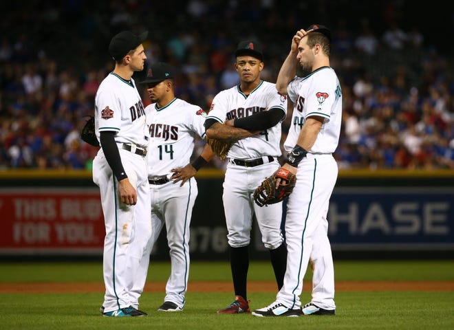 Arizona Diamondbacks Nick Ahmed, Eduardo Escobar, Ketel Marte and Paul Goldschmidt react as the fourth pitching change is made against the Chicago Cubs in the fifth inning on Sep. 18, 2018, at Chase Field in Phoenix, Ariz.