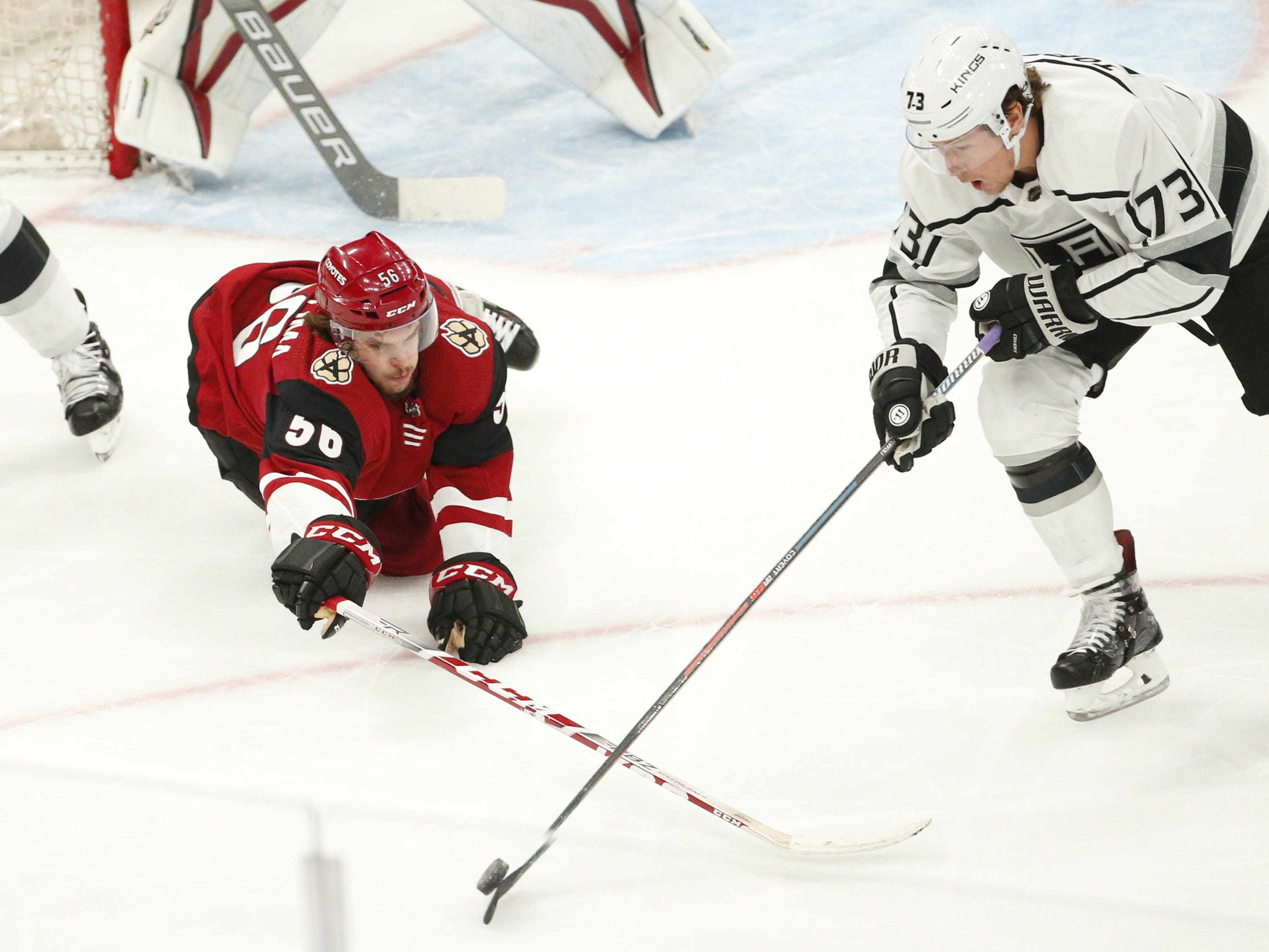 Arizona Coyotes left wing Kevin Klima swipes at the puck Los Angeles Kings right wing Tyler Toffoli (73) in the first period during pre-season NHL action at Gila River Arena in Glendale, Ariz. September 18, 2018.