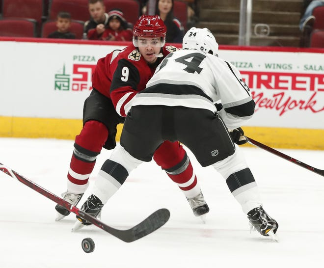 Arizona Coyotes center Clayton Keller (9) looks for the puck while defended by Los Angeles Kings defenseman Kale Clague (34) in the first period during pre-season NHL action at Gila River Arena in Glendale, Ariz. September 18, 2018.
