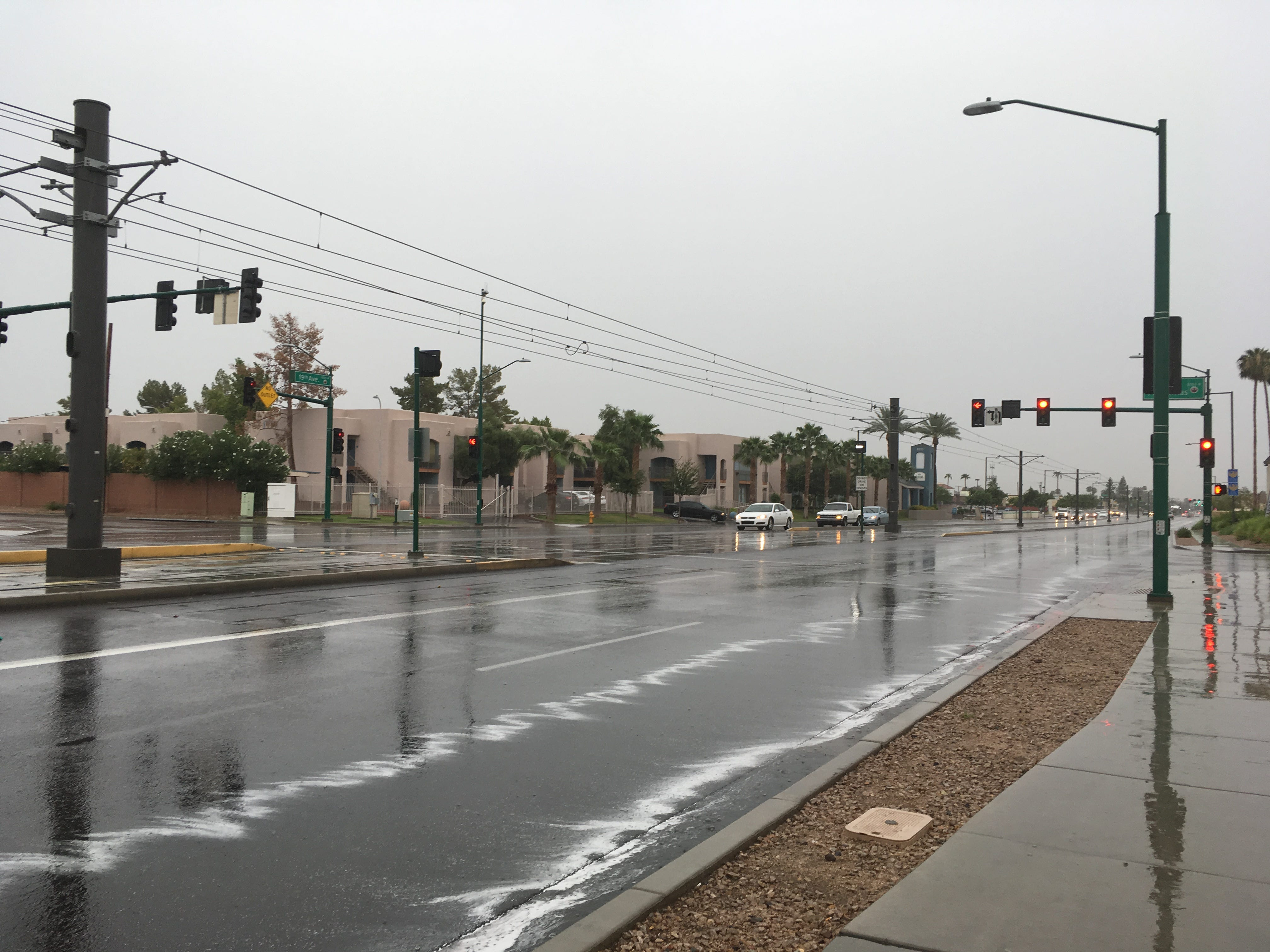 Rain falls on the light-rail station near Northern and 19th avenues in Phoenix on Sept. 19, 2018.