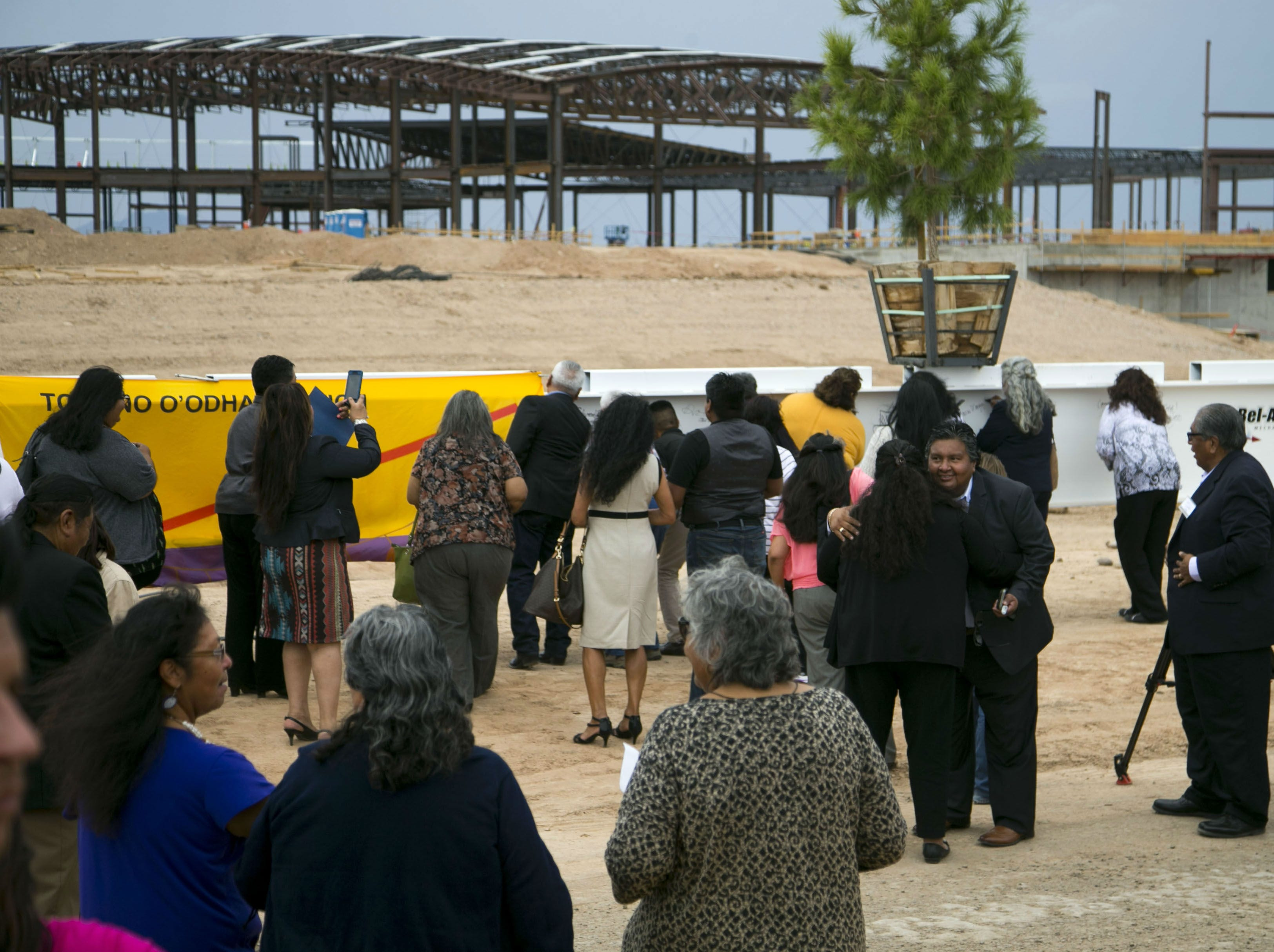 Members of the Tohono O'odham Nation and other dignitaries sign an I-Beam during a topping off ceremony to mark a construction milestone in the expansion of the Desert Diamond West Valley Casino in Glendale on Sept. 19, 2018.
