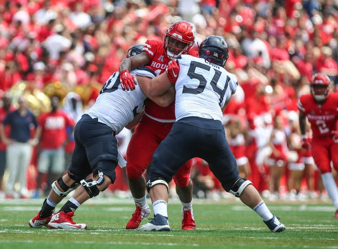Sep 8, 2018: Arizona Wildcats offensive lineman Josh McCauley (50) and offensive tackle Bryson Cain (54) attempt to block Houston Cougars defensive tackle Ed Oliver (10) during the game at TDECU Stadium.