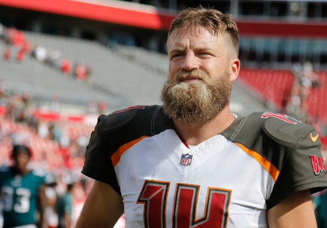 Buccaneers quarterback Ryan Fitzpatrick looks on before a game against the Eagles on Sunday.