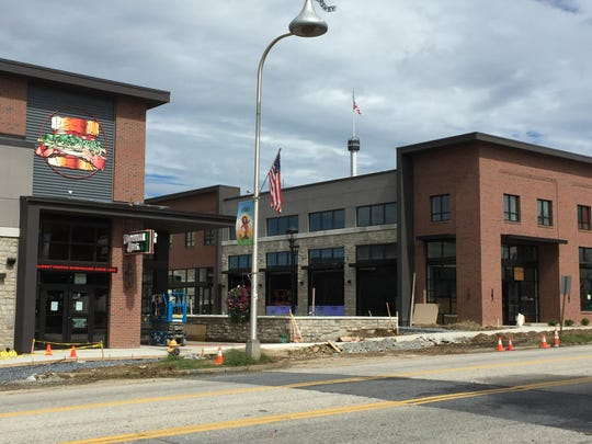 A 9,000-square-foot Iron Hill Brewery & Restaurant (right) will anchor Hershey Towne Square upon its completion in the fall.