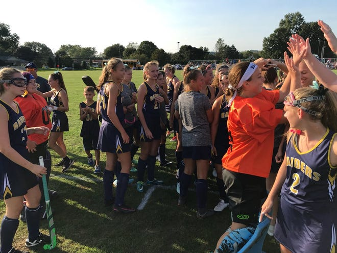 The Elco field hockey team celebrates Wednesday's tight 2-1 victory over Annville-Cleona in a battle of unbeaten teams.