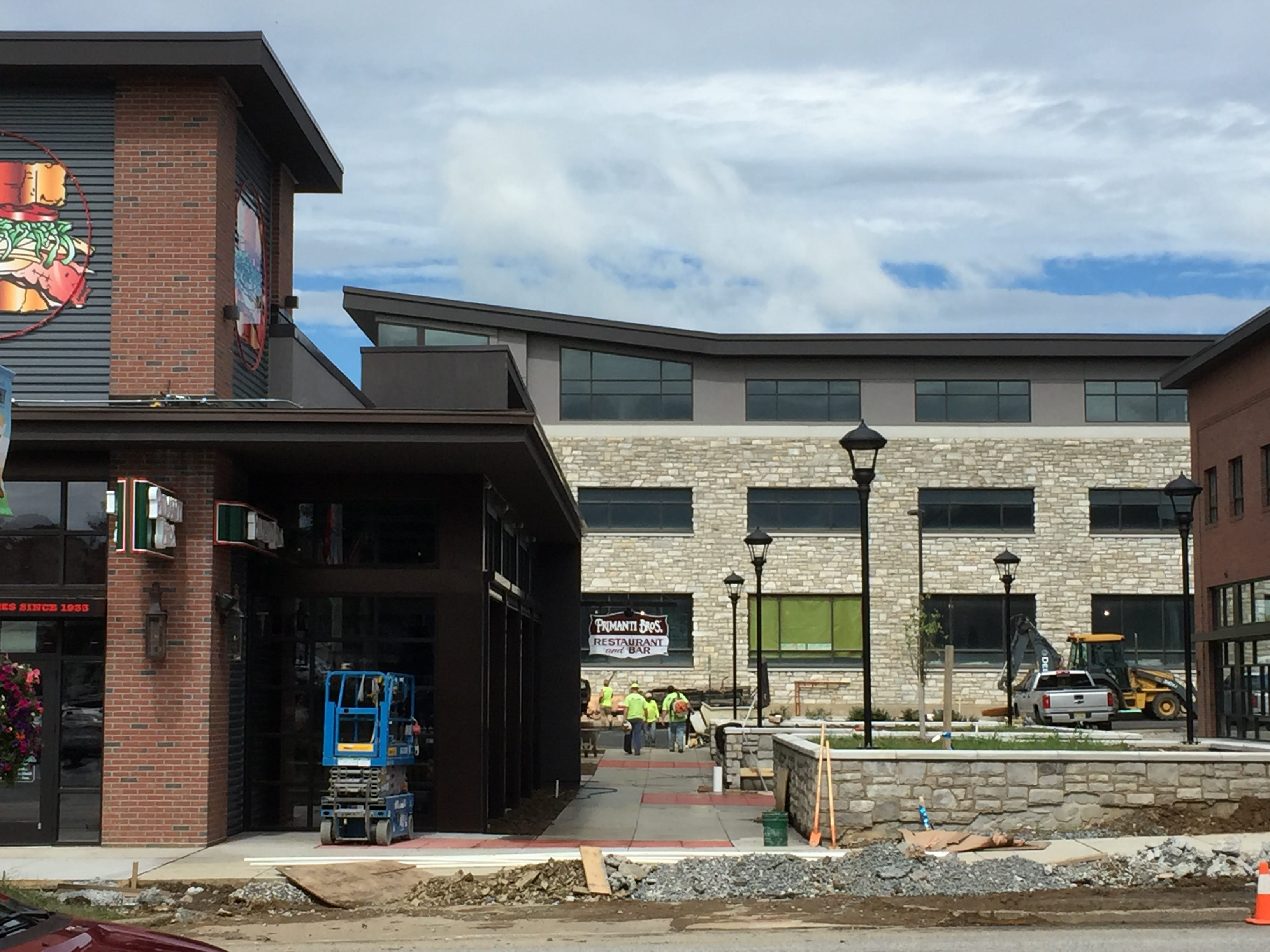 A three-story office building is visible between Primanti Bros. and Iron Hill Brewery at Hershey Towne Square.