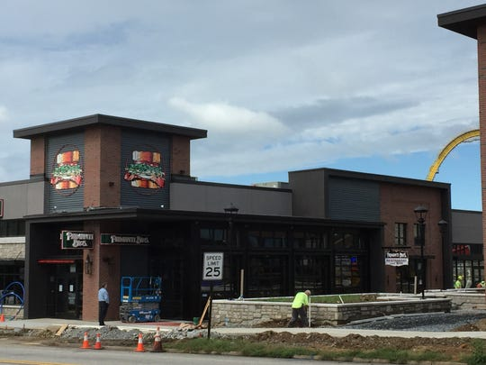 Workers are busy preparing for the Primanti Bros. opening on Wednesday, Sept. 26