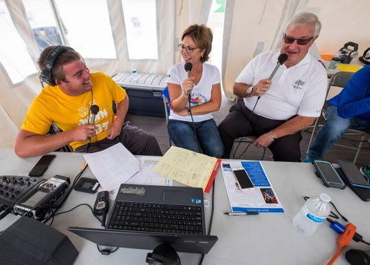 Paul Maxwell, right, speaks on the radio with St. Clair County CMH director Deb Johnson, center, and Q Country 107 WSAQ host Matt Markham Wednesday, Sept. 19, 2018, during the Community Roof-Sit for Kids' Rooftop Rally.