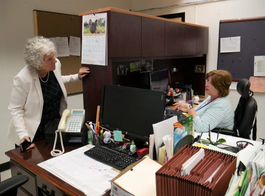 Poughkeepsie interim Superintendent of Schools Kathleen Farrell talks to Sheryl Small, a personnel assistant, at district offices on July 24, 2018.