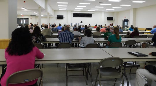 Dozens of people attended a public hearing on the proposed Transource power line project Tuesday at the New Franklin Fire Department's social hall.