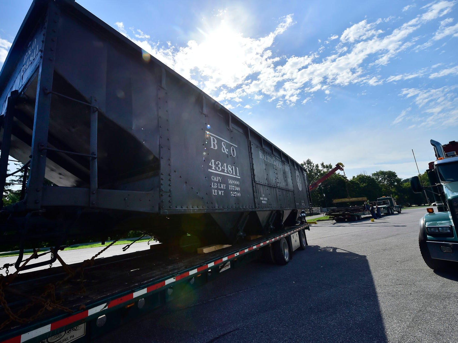 Dave's Trucking workers collect a railroad car on Wednesday, September 19, 2018 to move it to Shippensburg.