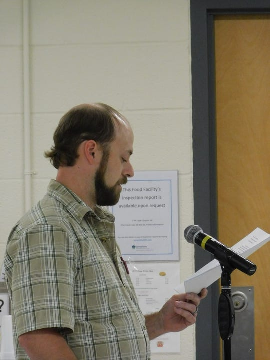 Aaron Kauffman spoke out against the use of eminent domain at a public hearing Tuesday on the Transource power line project. He said his family's farm, which already lost 13 acres to eminent domain in the 1960s when Interstate 81 was built, stands to lose more if the power line project is approved.
