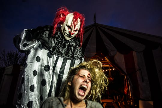 """Zeebo the Clown"" terrorizes a nameless woman (also a character, played by an actress) at Field of Screams in Mountville, Lancaster County."
