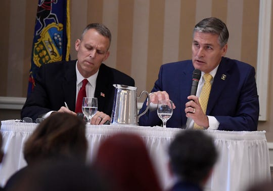 10th Congressional District candidates Republican Scott Perry, left, and Democrat George Scott, take part in a debate held by the Rotary Club of York at the Country Club of York, Wednesday, Sept. 19, 2018. John A. Pavoncello photo