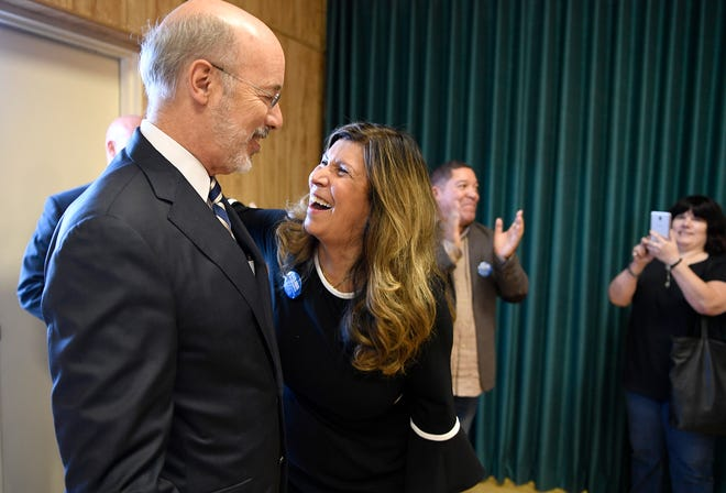 Governor Tom Wolf hugs Delma Rivera-Lytle, when arriving for Rivera-Lytle's campaign kick-off  for the 93rd State Legislative District, Tuesday, Sept. 18, 2018.  John A. Pavoncello photo