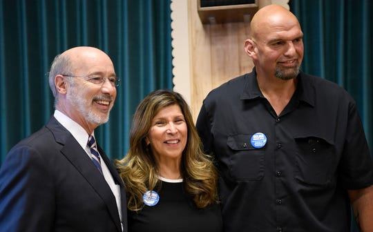 Governor Tom Wolf, Delma Rivera-Lytle, and Mayor John Fetterman, candidate for Lt. Governor, pose for a photo during a campaign kick-off event for Rivera-Lyle who is running for the 93rd Legislative District, Tuesday, Sept. 18, 2018.  John A. Pavoncello photo