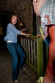 A frightened patron exits the Frightmare Asylum haunted house at Field of Screams in Mountville, Lancaster County.