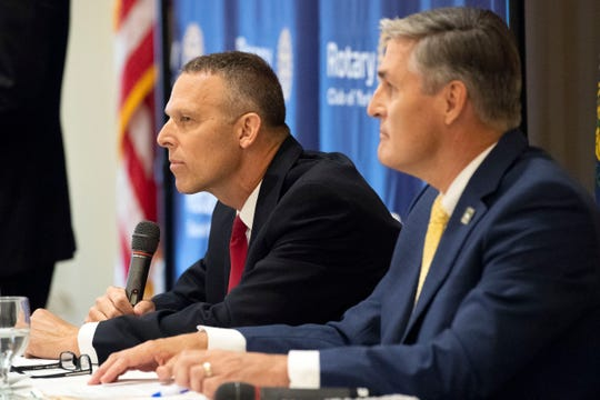 U.S. Rep. Scott Perry, R-York County, left, speaks during a debate with Democratic challenger George Scott at the Country Club of York on Wednesday. The two will compete in the Nov. 6 election for the newly created 10th Congressional District.