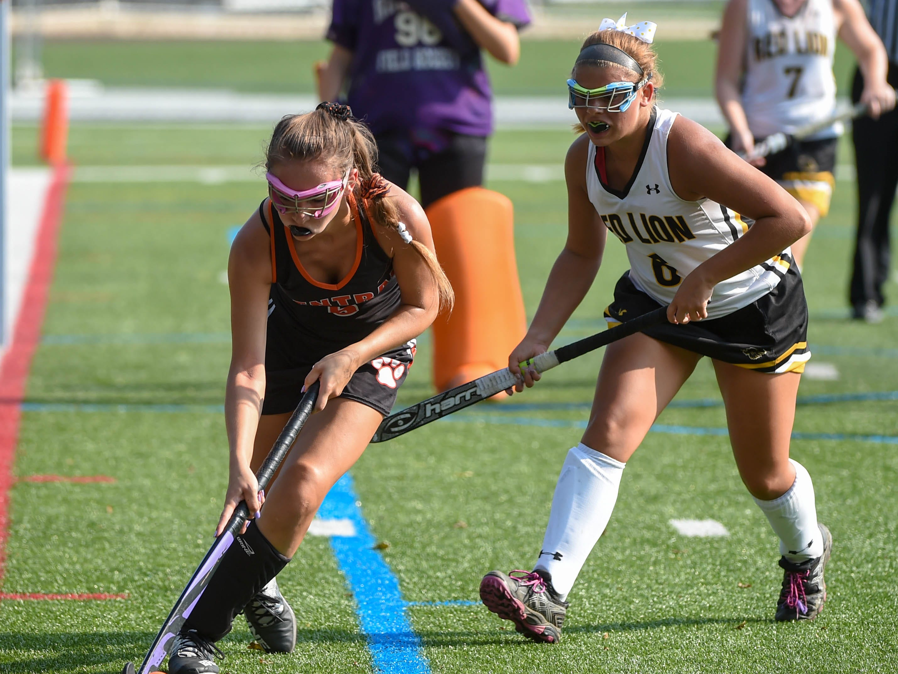 Caroline Blalock (5) takes the ball up the sideline during the Division I girls field hockey game between Red Lion and Central York, Wednesday, September 19, 2018.