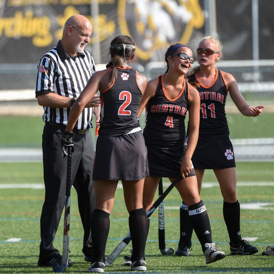 Victoria Whitehead (2), Breann Craley (4) and Kyra Heap (11) discuss a controversial call with the ref, Wednesday, September 19, 2018.