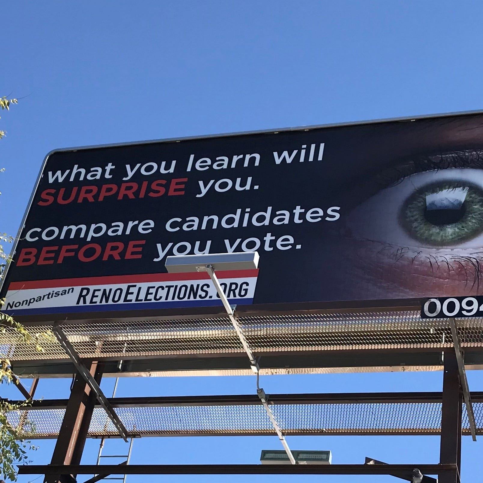 A billboard for RenoElections.org stands on East Fourth Street in Reno.