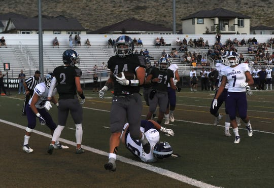 Damonte Ranch's Derrick Knoblock (44) scores while taking on Spanish Springs during their football game in Reno on Sept. 7, 2018.